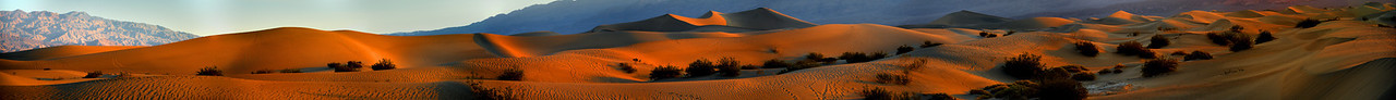 View full resolution: http://gigapan.com/gigapans/136495 Death Valley Sunrise I got up early in June 2013 to capture the sunrise on the Dunes in Death Valley. It was already around 100 F. Walking in the sand was hard and I wanted to shot them untouched. But when I got there some fool was on top taking a picture of the sunrise. To top it off he walked all over them. However I was lucky in the patten he walked added some interesting texture and capturing him talking photos added a different touch.  Orig image in PSB format is 1.5GB  had to re-size to  JPG 40 MP to upload Image size 137W X 17H inches Nikon D800 with the 28-300 Lens shot at 116mm  27 images (9 shots x 3 bracketing HDR)  There are 4 photographers in this image. Two have only their heads showing above a dune. The tallest dune has a dot on the top right. A Photographer shooting the sunrise. Another photo show this better on this site. In full resolution it is easy to see everything.